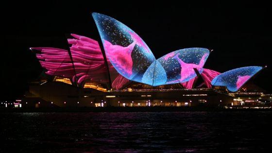 The Sydney Opera House, lit up at night